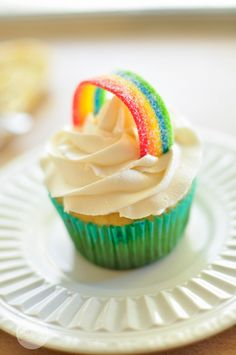 Top a fluffy white cloud of frosting with a candy rainbow. Top a fluffy white cloud of frosting with a candy rainbow.,Cupcakes Top a fluffy white cloud of frosting with a candy rainbow. Cupcake Recipes, Cupcake Cakes, Dessert Recipes, Dessert Food, Cupcake Toppings, Party Desserts, Mini Desserts, Frosting Recipes, Cake Cookies