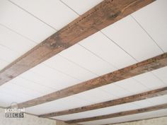 Love the look of a rustic farmhouse ceiling, but lack the barn? We've got a DIY tutorial to create a farmhouse faux barn beam ceiling from box store wood.