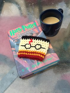 A personal favorite from my Etsy shop https://www.etsy.com/listing/466140266/harry-potter-themed-coffee-cup-cozy  Harry Potter mug gift, Harry Potter cup cozie cozy, accio coffee
