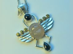 Sterling scarab pendant. Hand engraved wings, grossular garnet, moonstone and blue tourmalines