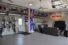 Great idea: turn one bay of the 3 car garage into a Man Cave...