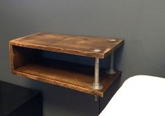 $99.  Industrial Floating Night Stand by Mostlywoodstuff on Etsy