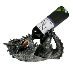 This exquisitely detailed dragon wine bottle holder provides a unique and beautiful way to display your favorite bottle of wine.  The piece features a dragon lying on its back in position to drink the wine.