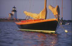 Herreshoff Alerion. I love black sailboats.