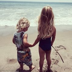 Beach-clad: Jessica Simpson took to Instagram on Thursday to share a photo of her children Ace, aged two,  and Maxwell, aged, while bonding at the beach