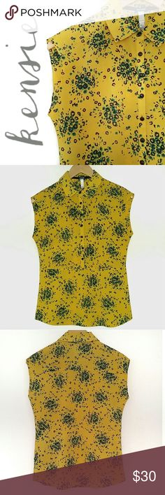 "SALE🌟 Kensie Yellow Floral Button Down Blouse 🎀15% Off Bundles🎀  This print goes everywhere! Delicate, feminine & vibrant black & teal floral bursts. Pairs well with work suits & everyday jeans for a pretty layer of color! Light feel & flowy flattering fit. Black buttons to the waist. Hem kind of flares at the bottom like a mock peplum fit. No signs of wear! Excellent condition!   {Measurements} Bust: 18"" Length: 25""  {Materials} 100% Polyester Kensie Tops Blouses"