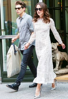 Keira Knightley in a white lace midi dress and metallic pumps