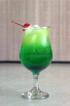 The Zolezzi cocktail with Midori, blue curacao, vanilla vodka, rum, pineapple juice and Sprite. Cocktail Mix, Cocktail Drinks, Cocktail Recipes, Midori Cocktails, Vodka Cocktails, Vodka Martini, Craft Cocktails, Mixed Drinks Alcohol, Alcohol Drink Recipes