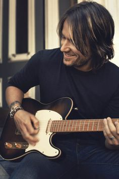 keith urban-he's my favorite country singer, and has had the best concerts I've ever been to!