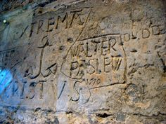 Robert Dudley, 1553, carved into the wall of Beauchamp Tower when he was held in the Tower of London following the Lady Jane Grey incident.  She was married to his brother Guildford.