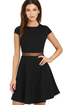 You'll fall head over heels for the Legendary Lovers Black Skater Dress! Medium-weight, stretch knit shapes a rounded neckline, and darted bodice, framed by cute cap sleeves. Sheer mesh waistband tops a twirl-worthy skater skirt. Hidden back zipper with clasp.
