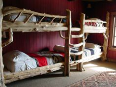 These bunk beds feature hand drawn log railings and ladder.