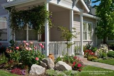 Front porch ideas - how about landscaping with rocks? A few large boulders make a year around statement. #LandscapingAroundHouse