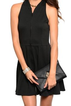Cool sleeveless skater style dress featuring an exposed zipper in the front and racer cut back