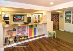 Basement Kids Play Room TV Area.  Room split in two.  Really clever use of space.