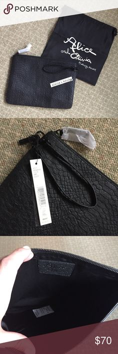 Alice & Olivia brand new black leather wristlet Never used, brand new, Alice & Olivia leather flat wristlet.  Tags still attached, see photos for exact measurement.  Purchased, forgot I had for years and now slowly purging my closet since this is no longer my style. Alice + Olivia Bags Clutches & Wristlets