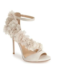 A garden of exquisite flowers blooms from toe to heel along the asymmetrical instep strap of this gorgeous satin