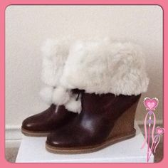 "Jessica Simpson Leather Upper Wedge Bootie Jessica Simpson Leather Upper Wedge Bootie.  Leather upper.  Rubber 4"" wedge heel.  4"" white faux fur trim with 2 faux fur Pom poms.  Only worn once, in excellent condition.  Although size in these boots is 7-1/2, and they do fit a 7-1/2 they are also a great fit for a size 7 and even a 6-1/2. Jessica Simpson Shoes"