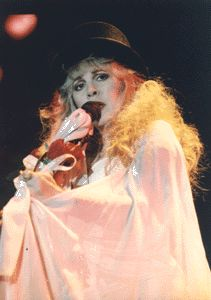 Stevie in a top hat and enveloping shawl onstage, looking rather tired; photo is from the early 90's ☆♥❤♥☆