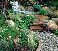 Retain a soft pebble pathway by using brick edging for support. Soft surfacing for garden paths consists of natural materials that include combinations of stone, wood and shell. Create a multiple line of plants as a backdrop and buffer from the neighbors. Garden Show, Dream Garden, Unique Gardens, Beautiful Gardens, Gravel Landscaping, Landscaping Ideas, Landscape Design, Garden Design, Design Jardin