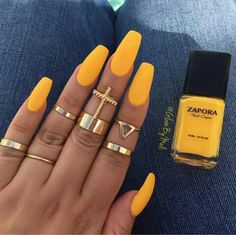 """""""Canary yellow one of my favorite yellow shades not to mention those stylish rings."""""""