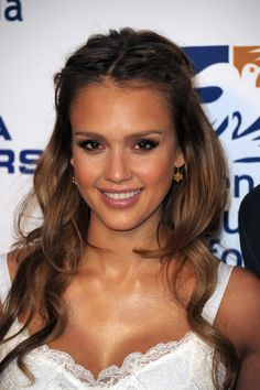 Jessica Alba Hair half up-leave in conditioner and volumizer spray before blow drying.