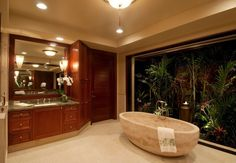 """Contemporary Master Bathroom with Standard height, Paint, 72"""" nubian sandstone tub, can lights, Louvered door, Durango, Flush"""