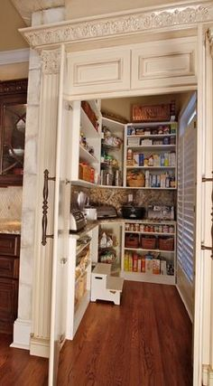This has to be the best pantry ever - inside & out!    The trim mouldings,  pediment & hardware are gorgeous & a counter is inside the pantry to store  appliances when not in use.