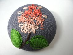 So pretty. Floral Brooch Embroidered Coral Flowers Pinback 15 by OverlyCrafty
