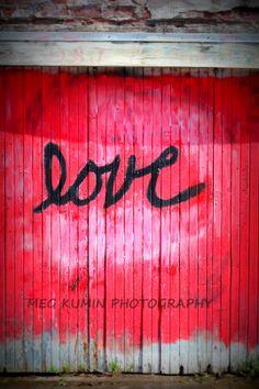 love on a garage door on memorial drive, in lawrence, ks