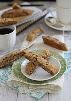 Ginger Almond Biscotti | runningtothekitchen.com 1½ cups almond flour ½ tablespoon cornstarch (substitute arrowroot powder for paleo) ¼ teaspoon salt ½ teaspoon baking soda 2 tablespoons orange juice ¼ cup honey ½ teaspoon vanilla extract ¼ teaspoon almond extract ¼ cup crystalized ginger, chopped ¼ cup sliced almonds 2 tablespoon cacao nibs