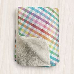 I'm filling up the shop with lots of gifts and goodies like this Rainbow Gingham Pattern design Sherpa Fleece Throw.  Visit Speckle Rock: https://specklerock.com, and Pin it to your favorite board. #smallbiz #homegoods #gifts  | This country gingham Sherpa fleece throw is designed with colorful rainbow gingham pattern mixed with white, with a super soft Sherpa material on the other side. It will keep you cozy and warm while you snuggle up in it. It's available in 2 sizes so you can find the…