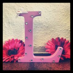 Freestanding Wooden Letter ' L ' handpainted in pink with white bow and diamante heart gems to finish.