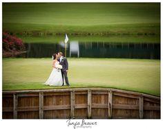 TPC Sawgrass Wedding; Tonya Beaver Photography; Ponte Vedra Beach Wedding; golf course wedding photos; bride and groom on green