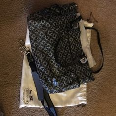 """Authentic Coach baby bag **Price is firm** Large black baby bag with numerous pockets outside and inside; grey and white """"C"""" design on outside; purple lining inside; shoulder strap and changing mat (never used) included; Price is Firm Coach Bags Baby Bags"""