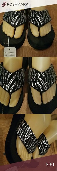 New GRAZIE Zebra Rhinestone Flip Flops 5 New GRAZIE black and silver zebra rhinestone flip flops. Straps are adorned with black and clear rhinestones. Super soft Eva foot bed. Size 5 Grazie Shoes Sandals