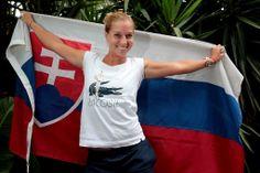 Dominika Cibulkova poses with the Slovakian flag. - Fiona Hamilton/Tennis Australia