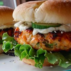 These GRILLED SALMON BURGERS may end up being the best burgers you ever make. Imagine chopped fresh Atlantic salmon mixed together with ginger, scallions, sesame and jalapeno - grilled to perfection - topped with an amazing wasabi, ginger mayo. Salmon Burgers Canned, Healthy Salmon Burgers, Beef Burgers, Lemon Dill Salmon, Ginger Salmon, Pan Seared Salmon, Grilled Salmon, Grilled Fish, Salmon Patties Recipe