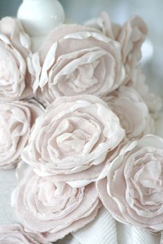 Roses made out of cashmere sweaters!  Inspiration.