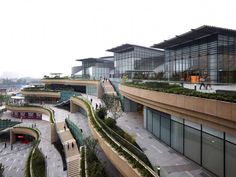 Completed in 2012 in Chengdu, China. Callison, a global architecture and design firm, announced the completion of the MixC (the first phase of 24 City) in Chengdu, China. Urban Architecture, Commercial Architecture, Amazing Architecture, Urban Landscape, Landscape Design, Terrace Building, Mall Facade, Patio Central, Mall Design