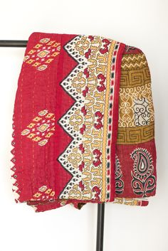 Kantha throw blankets are six layers of vintage saris, hand-stitched together by women in Bangladesh using a traditional kantha stitch. - Made of 100% reclaimed cotton sari cloth - Throws are half the