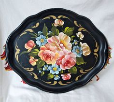 Hey, I found this really awesome Etsy listing at https://www.etsy.com/listing/151662093/vintage-tole-trayblack-with-flowershand