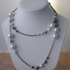 Fabulous diamante chain and faux pearl necklace Mixed beads makes this a contrasting and very eye catching modern jewellery White faux pearl beads with gold