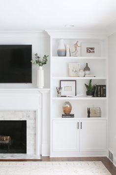 B's white built-ins around the fireplace are installed and you will NOT believe this dramatic before and after. Sharing all the details about this gorgeous investment. # fireplace shelves, White Built-Ins Around the Fireplace: Before and After Bookshelves Around Fireplace, Built In Around Fireplace, Fireplace Built Ins, Home Fireplace, Bookshelves Built In, Decorate Bookshelves, Tv Above Fireplace, Bookcases, Furniture Around Fireplace