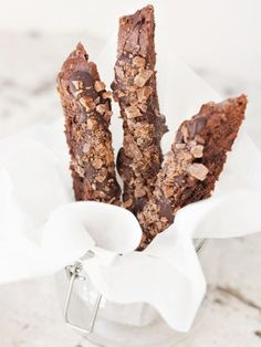A decadent chocolate toffee biscotti recipe, topped with a generous drizzle of dark chocolate and a sprinkling of crushed toffee chocolate bars.