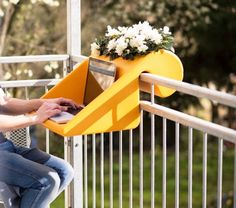 The BalKonzept is a German designed desk for your balcony. Just place it over the railing on your balcony and you have a desk to work at, a table to set your drinks on, or a place to put some flowers.  http://odditymall.com/balkonzept-a-balcony-desk-and-flower-box