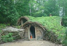 Rustic earth-sheltered home with a beautiful grass roof