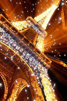 "By Ingiro, Gabrele Caretti.  Eiffel Explosion of Stars.  ""Is a zoom effect not photoshopped, the same tecnique of the colosseum one posted some days ago. I toke it during the sparkling lights effect this is to explain because so many stars in the picture."""