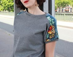 Very elegant way to refashion a sweat shirt. Add cross stitch fabric on shoulders make short or long sleeved: