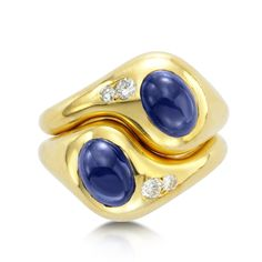 "Van Cleef and Arpels Ring ""lovers knot"" ring. In 18K gold, with sapphire cabochon and diamond, designed as two entwined bombe gypsy set mount with knotted hoops from the 1970s."